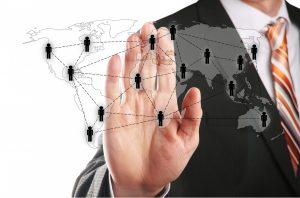 businessman's hand with global network overlay